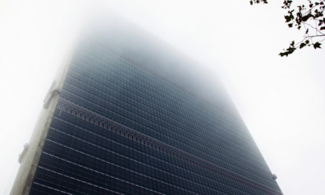 A view of UN Headquarters' Secretariat building immersed in morning fog (c) UN Photo