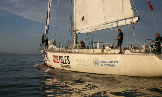 A Clipper 68 training yacht with the UNA Climate and Oceans Logo